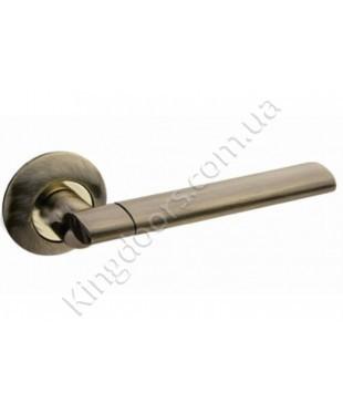 Дверная ручка на круглой розетке Модель Бристол. Цвет бронза