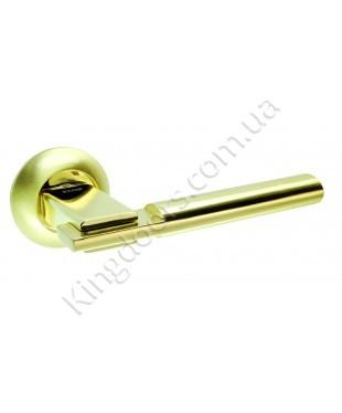 Дверная ручка на круглой розетке Модель Тринити. Цвет полированная латунь (золото)