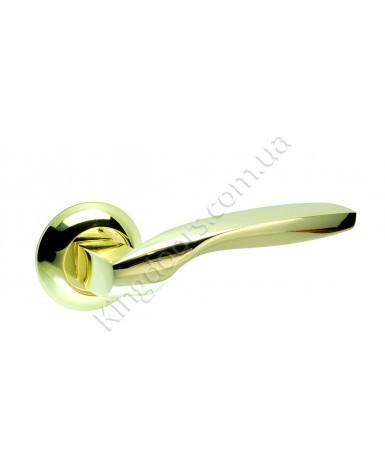 Дверная ручка на круглой розетке Модель Гранд. Цвет полированная латунь (золото)